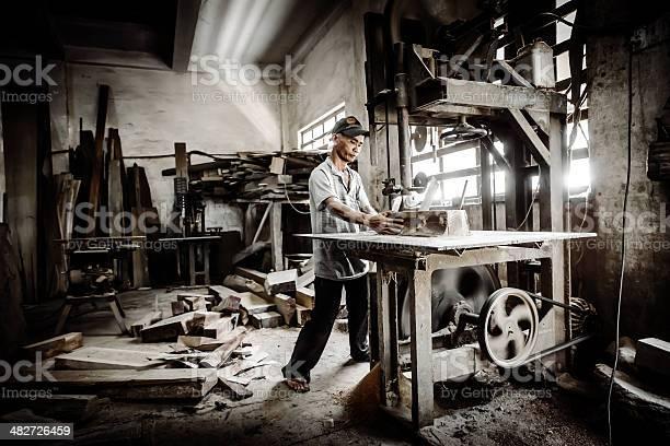 Manual Worker In Carpenter Workshop Vietnam Stock Photo - Download Image Now