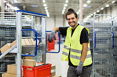 istock Manual worker in large distribution warehouse 875008158