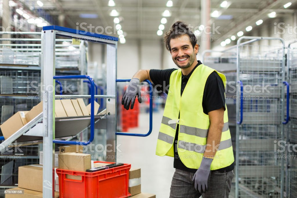 Manual worker in large distribution warehouse stock photo