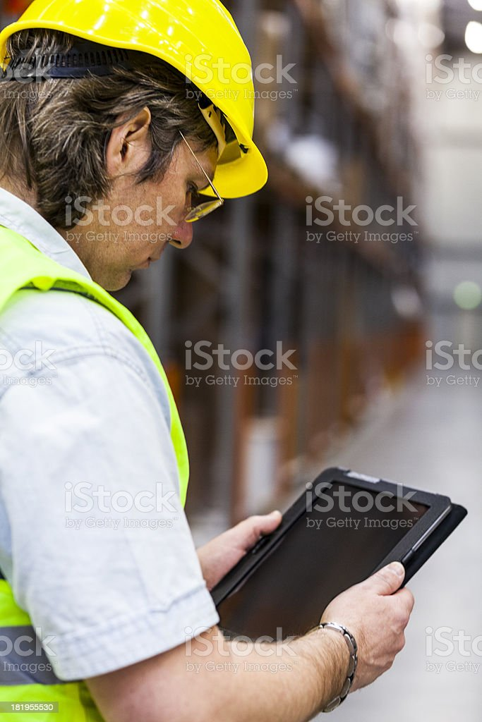 Manual worker in warehouse royalty-free stock photo