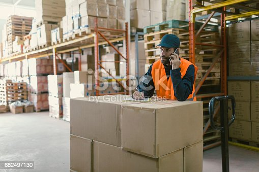 istock Manual worker in warehouse 682497130