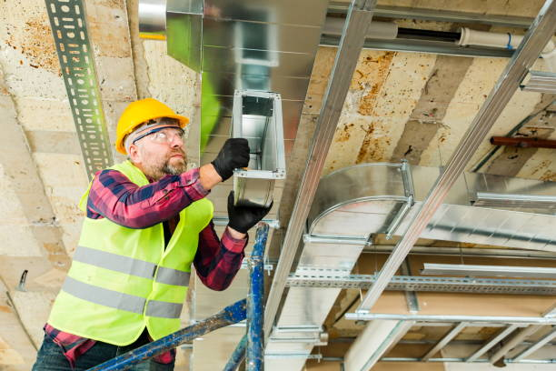 Manual Worker  installing air conditioner in building stock photo