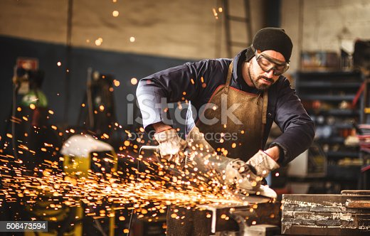 istock manual worker on a workshop 506473594