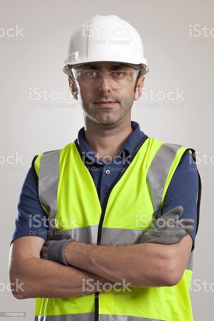 Manual worker portrait wearing safety gear stock photo