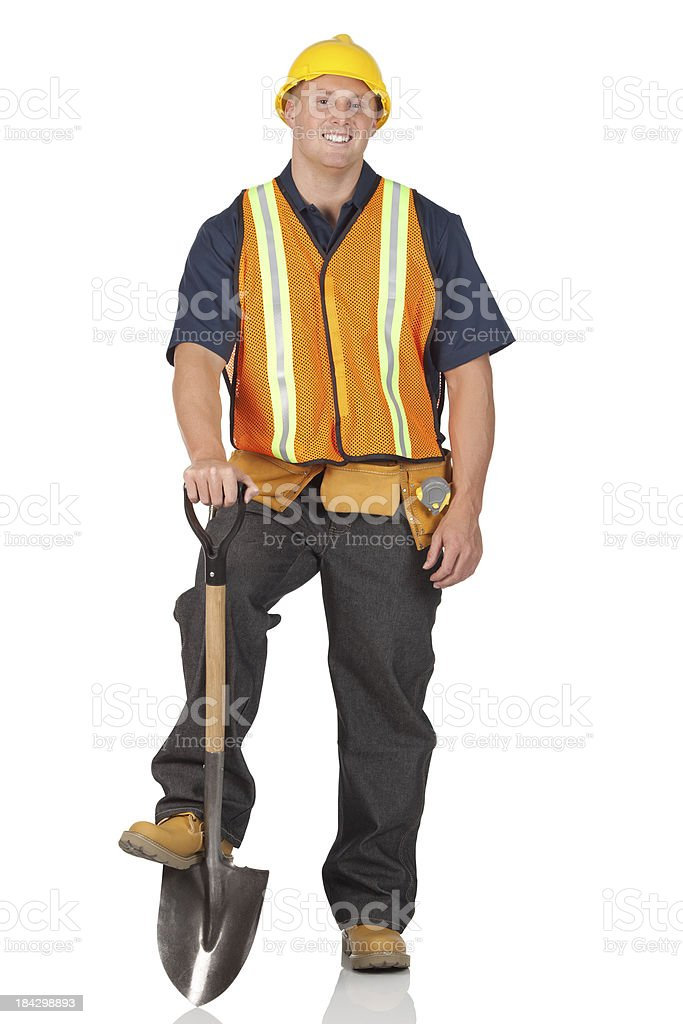 Manual worker standing with a shovel stock photo