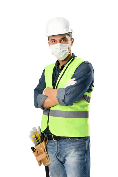 Manual Worker wearing Face Mask and Protective Gloves stock photo