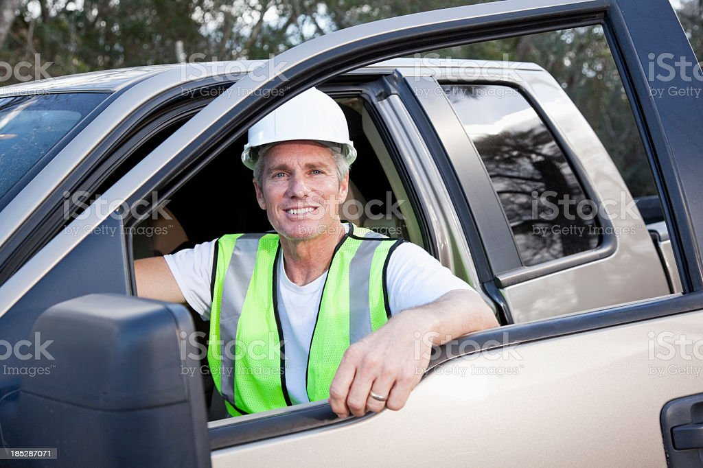 Manual worker wearing hardhat and safety vest royalty-free stock photo