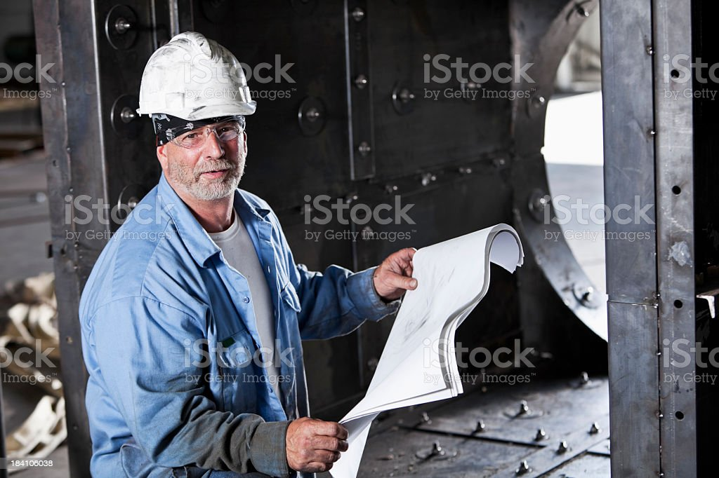 Manual worker wearing safety glasses and hard hat royalty-free stock photo