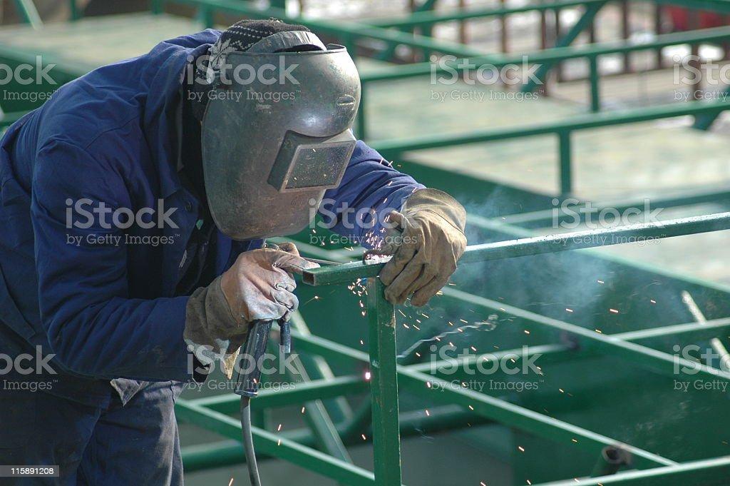 Manual worker welder welding metal construction stock photo