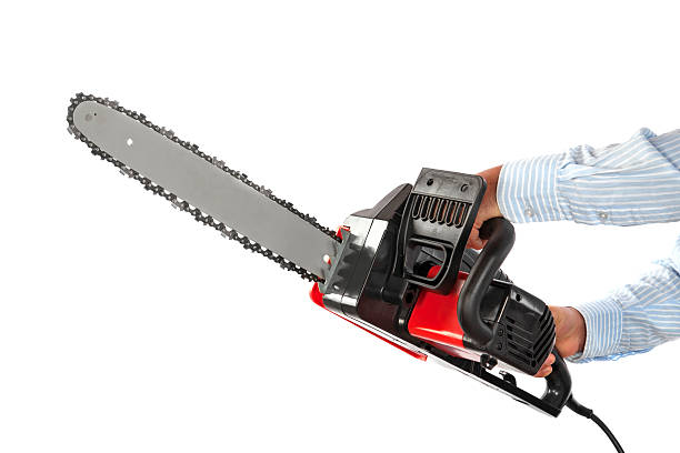 manual worker with chainsaw - chainsaw stock photos and pictures