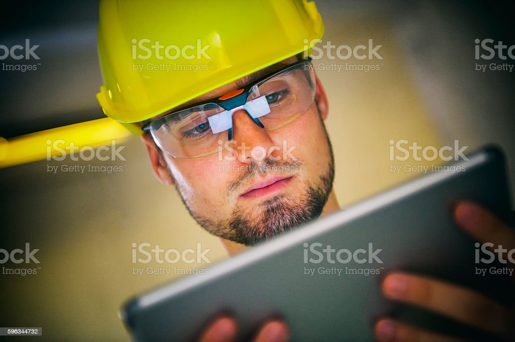 Manual worker with digital tablet royalty-free stock photo