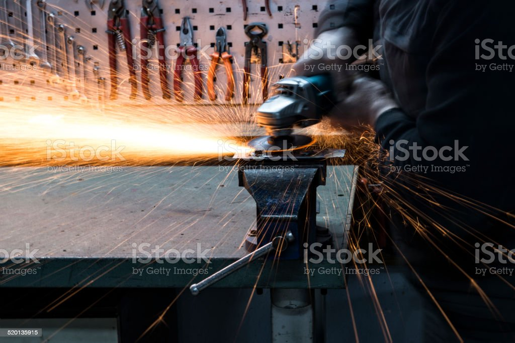 Manual worker with grinder stock photo