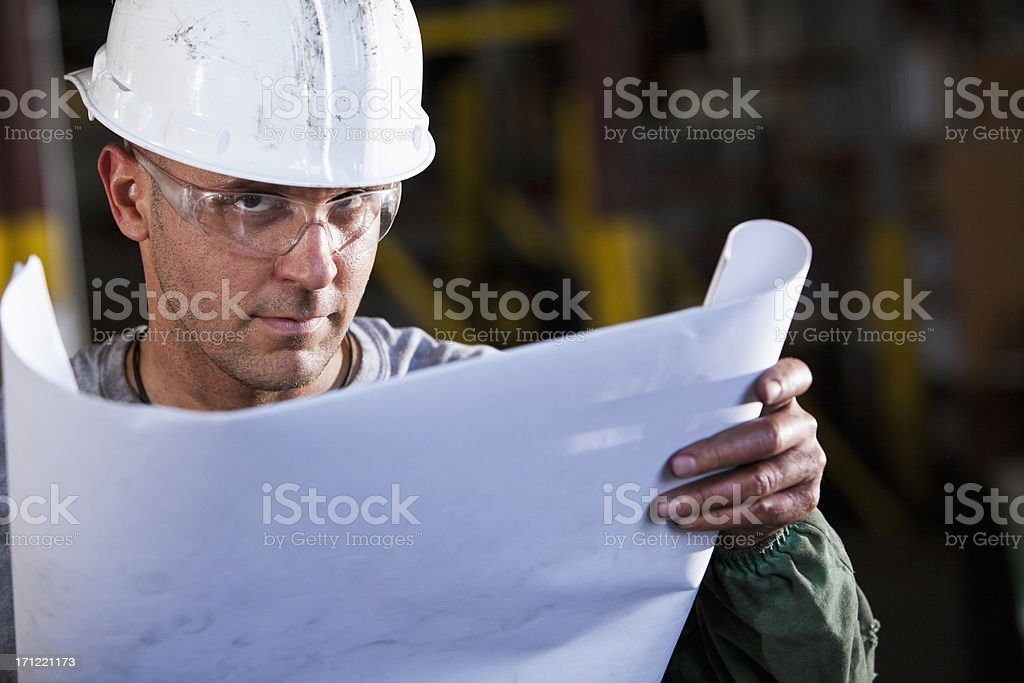Manual worker with plans royalty-free stock photo