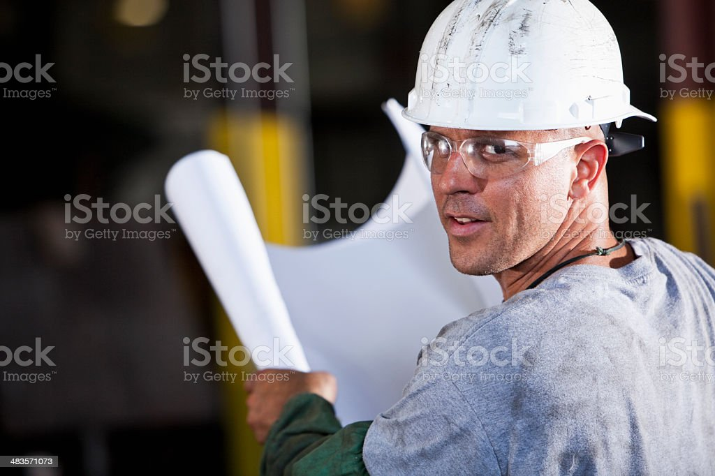 Manual worker with plans stock photo