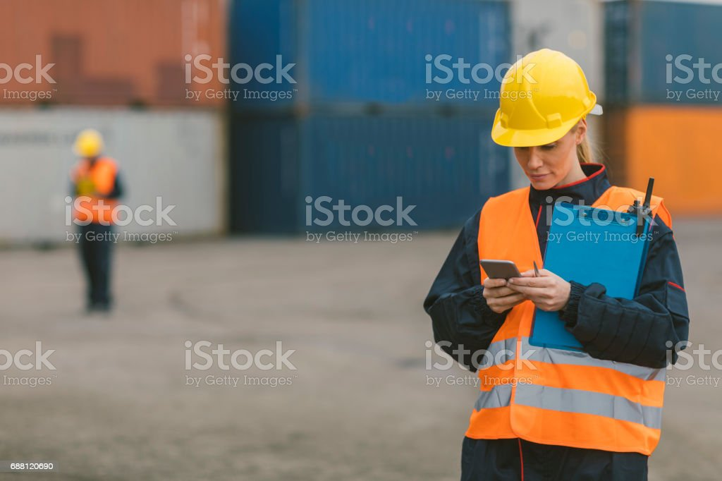 Manual workers checking cargo containers stock photo