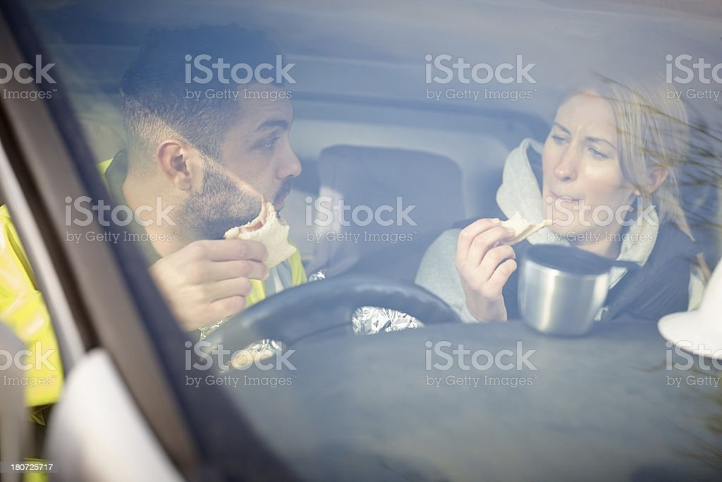 Manual workers having a short lunch break royalty-free stock photo
