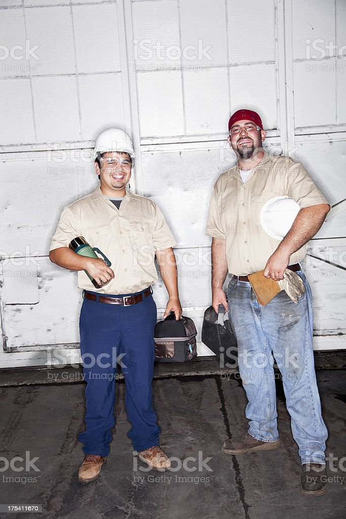 Manual workers taking a lunch break stock photo