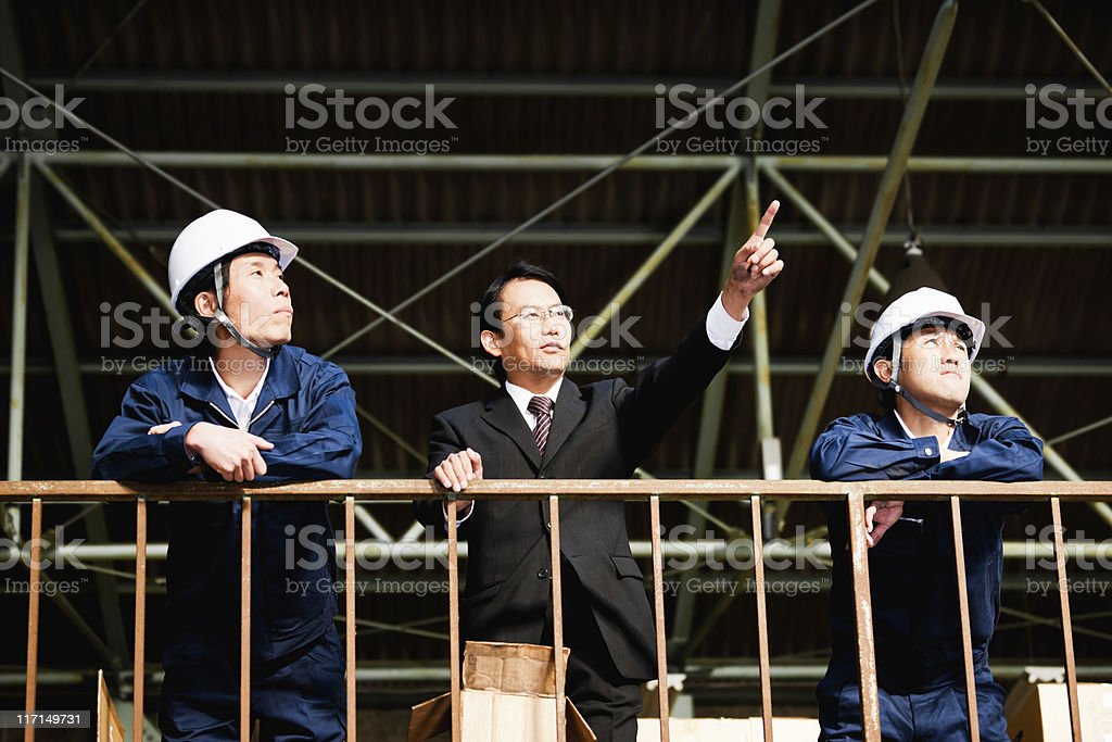 Manual Workers with Visonary Boss Industry Warehouse Portrait royalty-free stock photo