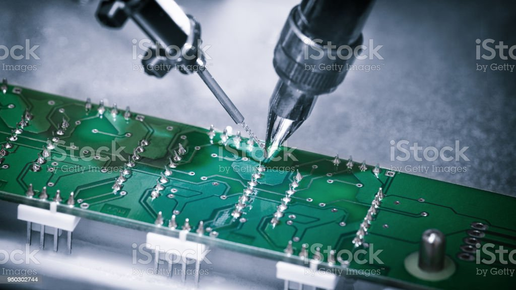 manufacture of chips on a printed circuit board under a microscopemanufacture of chips on a printed circuit board under a microscope royalty free stock photo