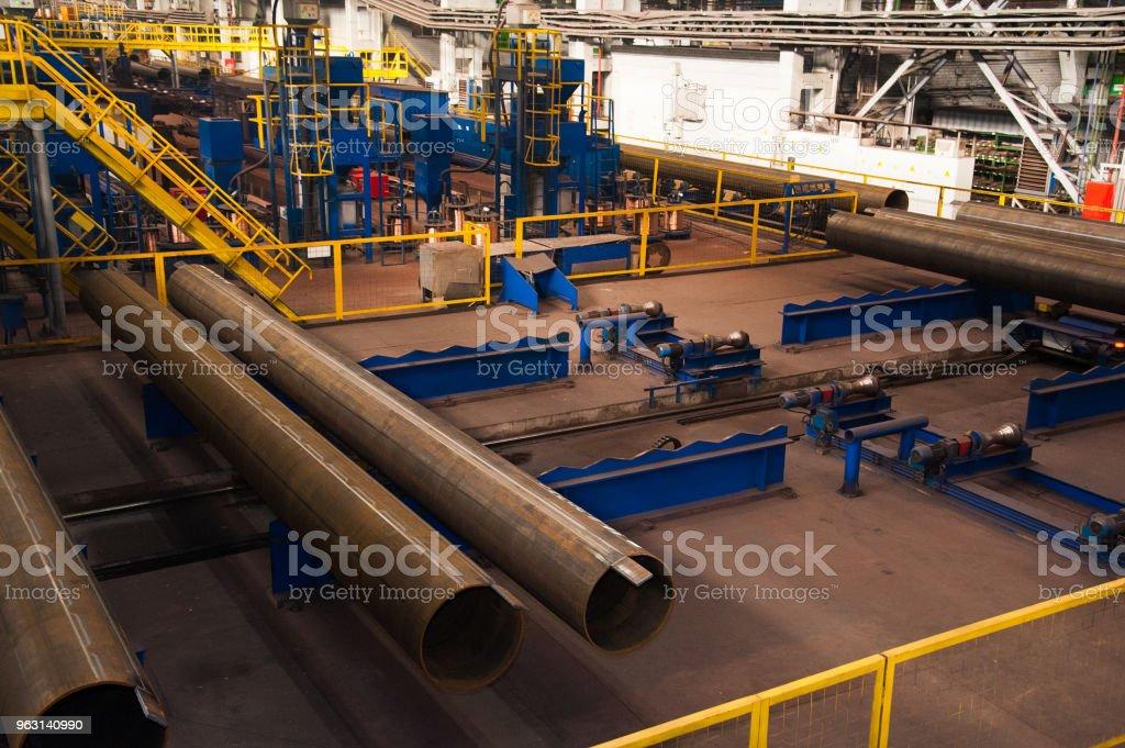 Tillverkning av stålrör - Royaltyfri Energiproduktion Bildbanksbilder