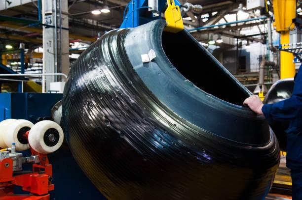 manufacture of tires - materiale gommoso foto e immagini stock