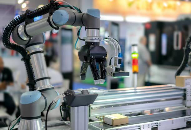 robot de fabricación - robot fotografías e imágenes de stock