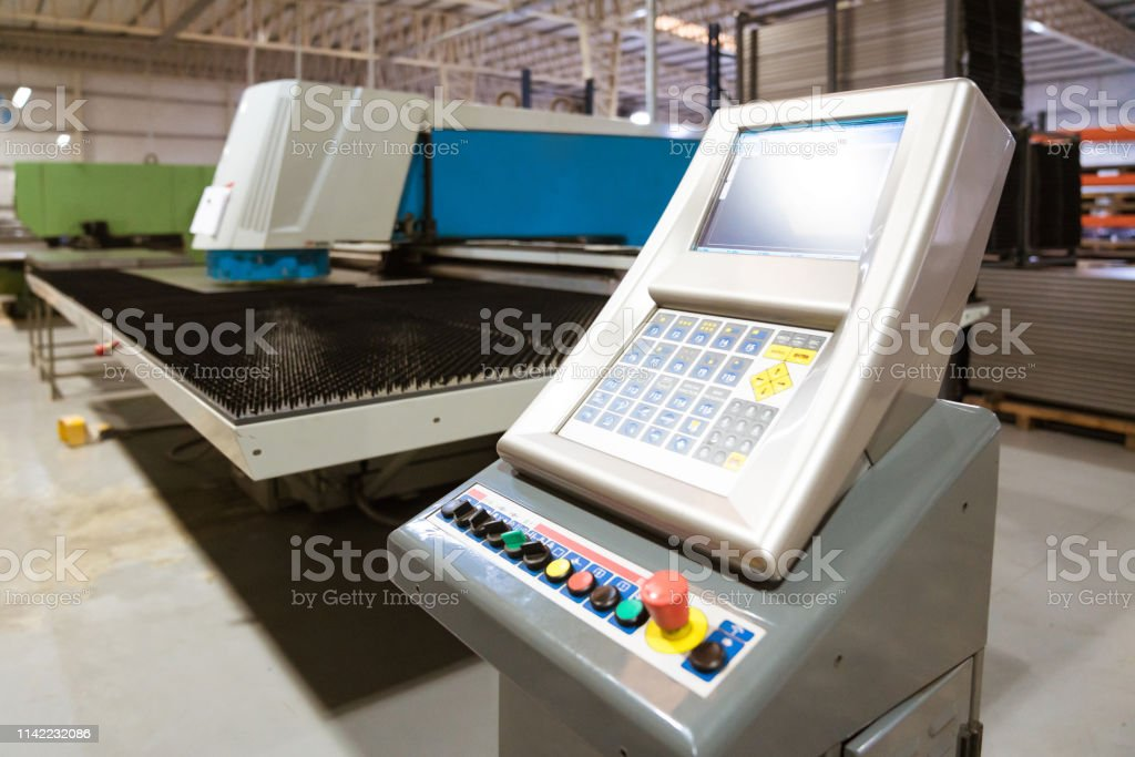 Manufacturing machinery in industry Close-up of puller machine in factory. Manufacturing machinery in industry. Absence Stock Photo