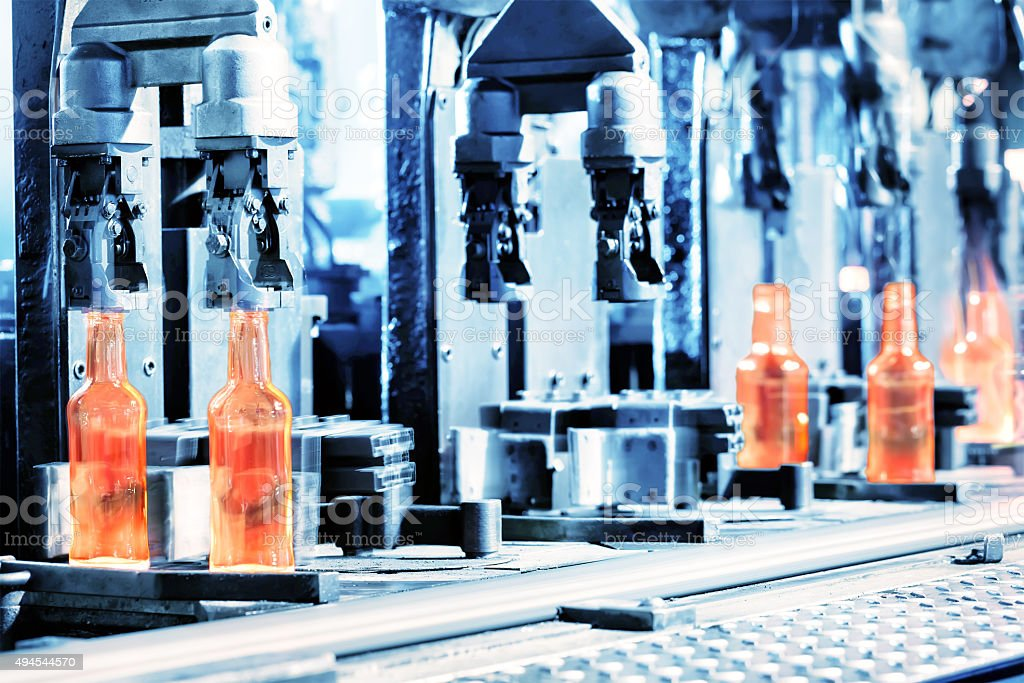 Manufacturing process of bottles stock photo