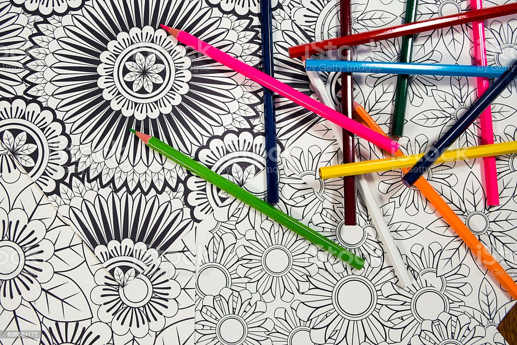 Many Adult Coloring Book Designs With Pencil Crayons Stock Photo ...