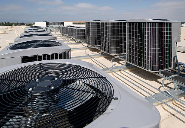 Many air conditioning units outside stock photo
