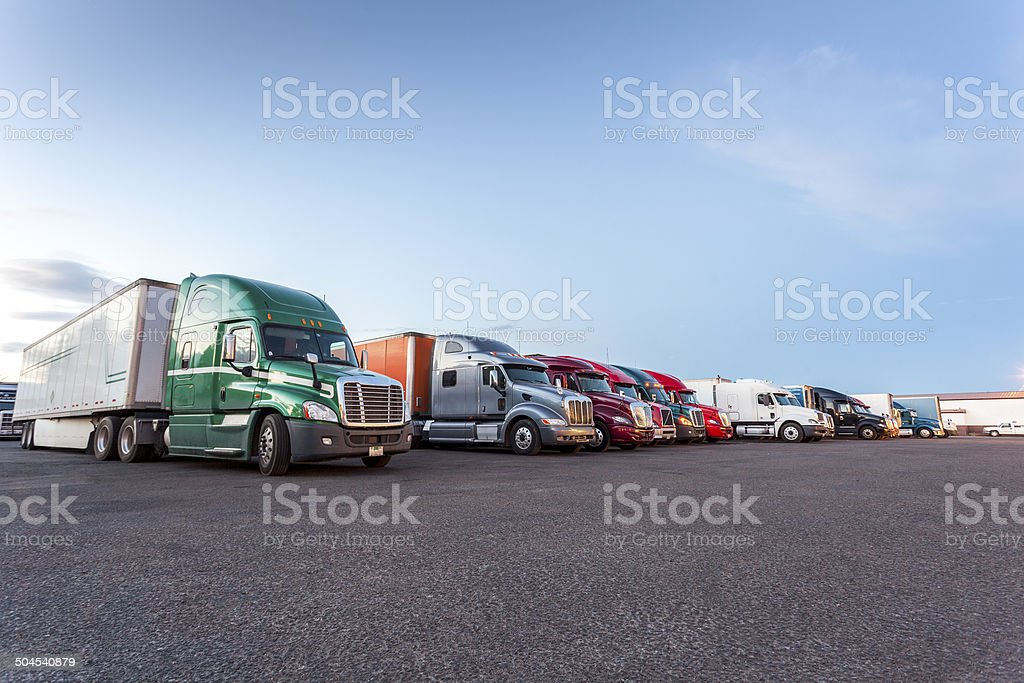 Many American trucks on parking lot. stock photo