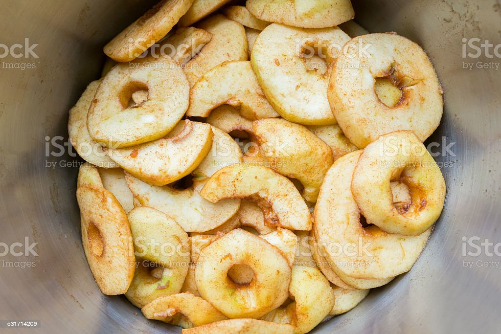 Many apple slices in metal pan stock photo