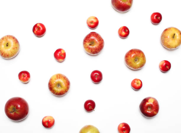 Many apples fruits on a white background stock photo