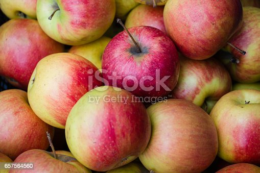 istock many apples in closeup 657564560