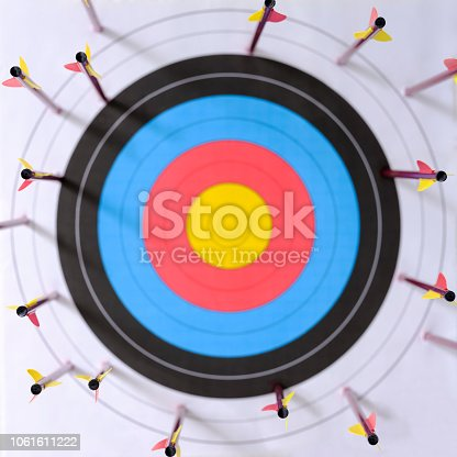 istock Many arrows around the edges of a sports target with a very low score relating to missing the target. 1061611222