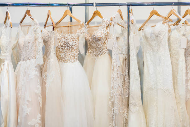 Many beautiful wedding dresses Many beautiful wedding dresses hang in the store dress stock pictures, royalty-free photos & images