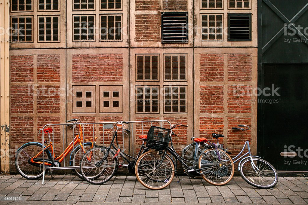 Many bicycles in a row on the street in Amsterdam, in Europe. Parking for bicycles. Eco-friendly and healthy means of transportation around the city. Conceptual image. stock photo