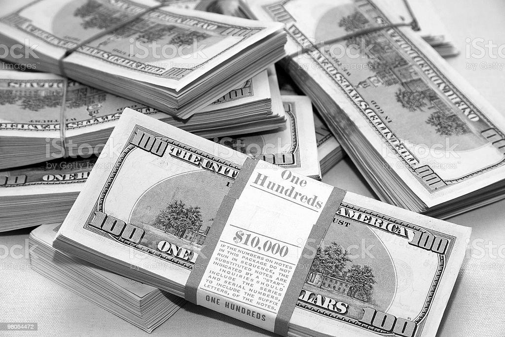 Many big packs of dollars over white sacking royalty-free stock photo
