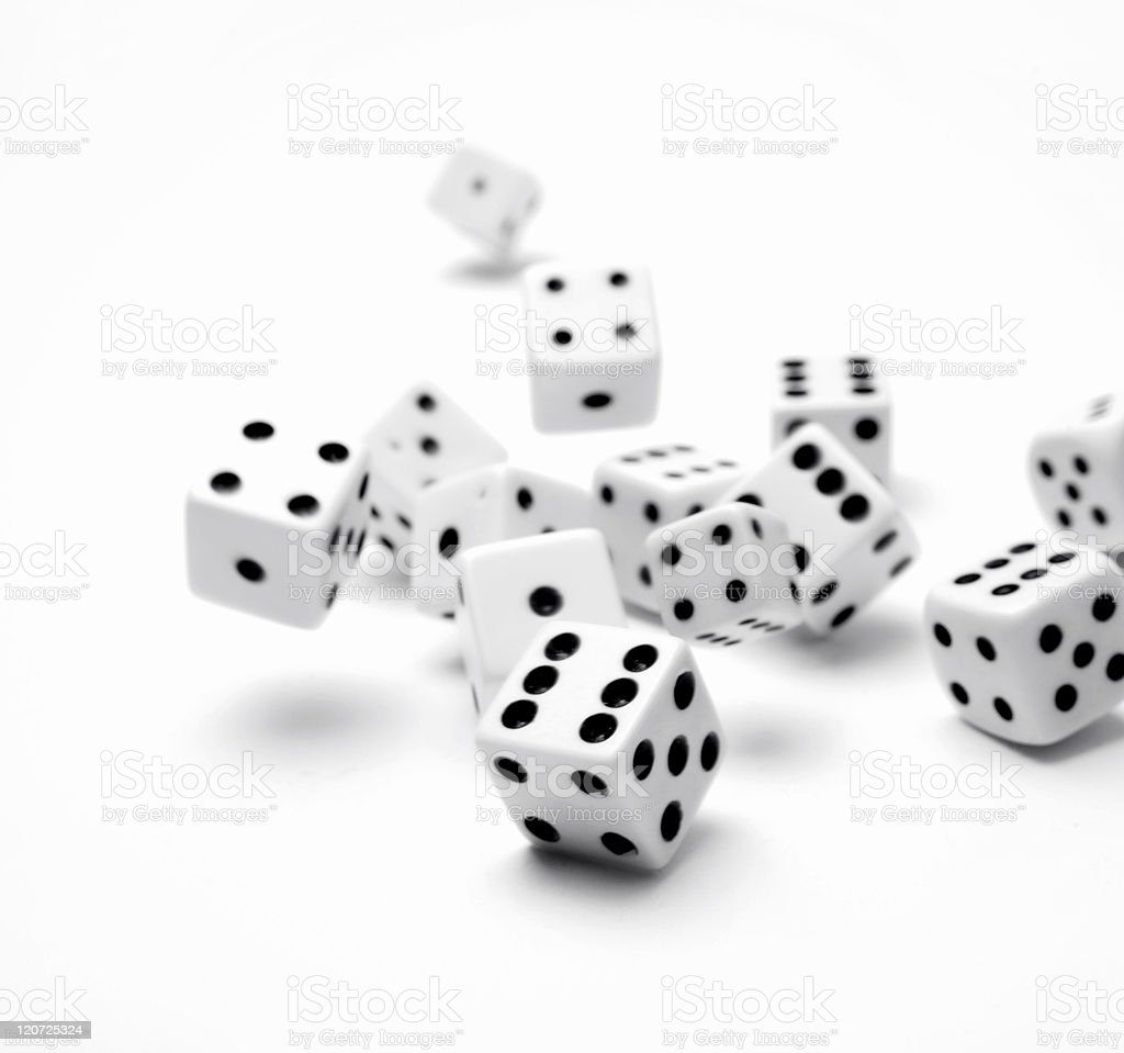 Many black and white dice on a white background stock photo