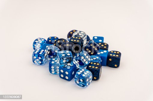 istock Many blue dice in different shades of blue 1222609087