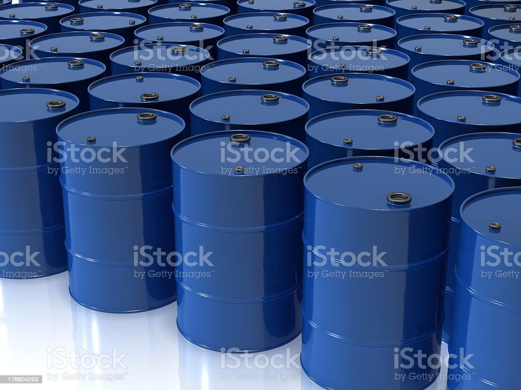 Many blue oil drums on a white surface stock photo