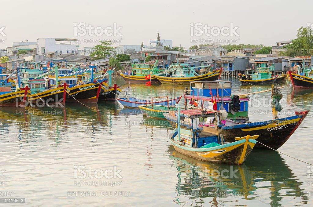 Many boats docking in fishing pier in Mui Ne town stock photo
