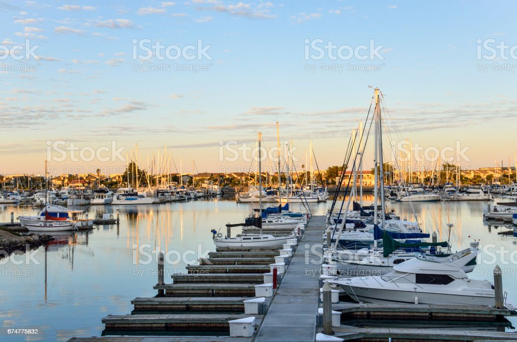 Many boats on marina during sunrise in Oxnard, California stock photo