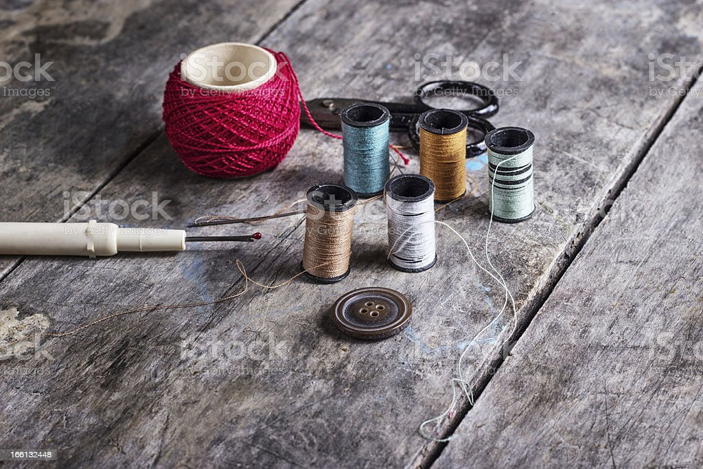 Many bobbin of thread with needle and button royalty-free stock photo