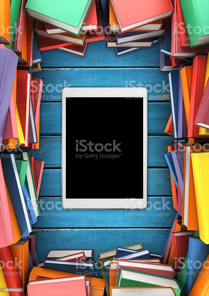 many books and tablet on the table – Foto