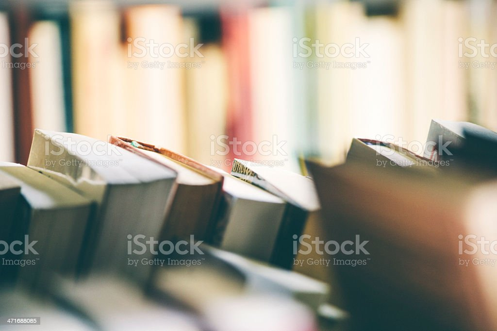 Many books on bookshelf. stock photo
