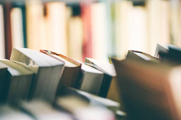 Many books on bookshelf. stock photo
