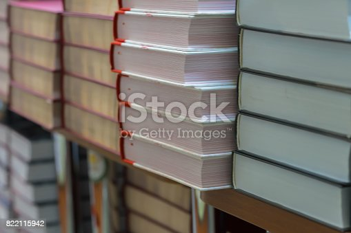 istock Many books, textbooks or fiction in rows lying on shelves in library or in modern urban bookshop. Self-study, educational, manuals, textbooks, school, study concept. Blurred abstract background 822115942