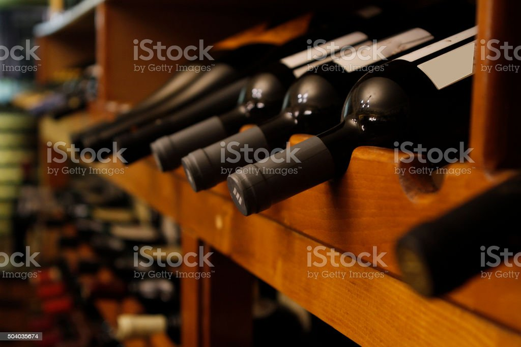 many bottles of wine in a row stock photo