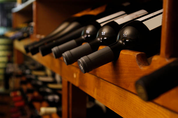many bottles of wine in a row many bottles of wine in row perspective in a cellar cellar stock pictures, royalty-free photos & images